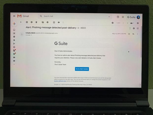Photo of Gmail (on laptop) to G Suite administrator: You have an admin alert about Phishing message detected post-delivery that requires your attention. Please view alert details in G Suite Alert Center.